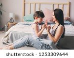 mother playing with child son... | Shutterstock . vector #1253309644