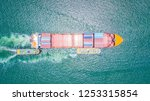 cargo ship carries the... | Shutterstock . vector #1253315854