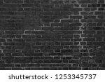 black brick wall concrete... | Shutterstock . vector #1253345737