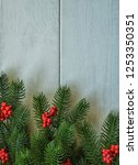 christmas wooden background... | Shutterstock . vector #1253350351