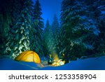 couple camping with campfire... | Shutterstock . vector #1253358904
