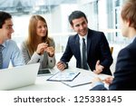 Small photo of Image of business partners discussing documents and ideas at meeting