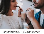 couple resting in cafe. couple... | Shutterstock . vector #1253410924