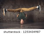 young man break dancing on the... | Shutterstock . vector #1253434987