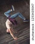 young man break dancing on the... | Shutterstock . vector #1253435047