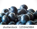 group of blueberries on a white ... | Shutterstock . vector #1253465884