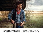brutal cowboy with his hand on...   Shutterstock . vector #1253469277