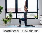 active senior woman practicing... | Shutterstock . vector #1253504704