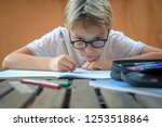 cute blond child with glasses... | Shutterstock . vector #1253518864