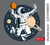 astronaut playing basketball in ... | Shutterstock .eps vector #1253548804
