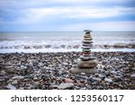 relaxation at sea. stack of... | Shutterstock . vector #1253560117