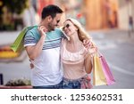 portrait of happy couple with... | Shutterstock . vector #1253602531