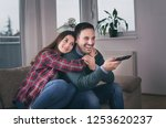 happy young couple watching tv... | Shutterstock . vector #1253620237
