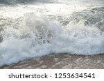 sea foamy waves seashore  | Shutterstock . vector #1253634541