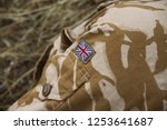 uk patch flag on soldiers arm.... | Shutterstock . vector #1253641687