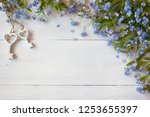 forget me nots and  keys on a... | Shutterstock . vector #1253655397