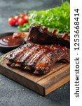 closeup of pork ribs grilled... | Shutterstock . vector #1253668414