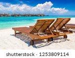 wooden sunbed on tropical beach ...   Shutterstock . vector #1253809114