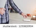 business man holding laptop and ... | Shutterstock . vector #1253820904