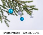 silver and blue balls on spruce ... | Shutterstock . vector #1253870641