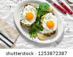 top view healthy avocado toasts ... | Shutterstock . vector #1253872387