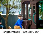 little boy climbing ladder on... | Shutterstock . vector #1253892154