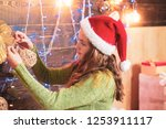 cute little girl is decorating... | Shutterstock . vector #1253911117