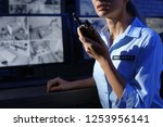 female security guard with... | Shutterstock . vector #1253956141