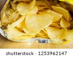 potato chips open bag on wood... | Shutterstock . vector #1253962147
