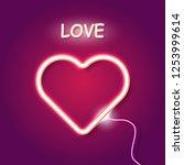 red neon heart on purple... | Shutterstock .eps vector #1253999614