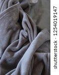 warm fluffy messy gray blanket | Shutterstock . vector #1254019147