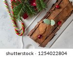 Small photo of Bush de Noel Christmas Log Cake and New Year background. Copy space.