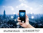 smart phone in hand and using... | Shutterstock . vector #1254039757