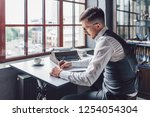 young man writing the... | Shutterstock . vector #1254054304