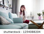 cheerful woman browsing... | Shutterstock . vector #1254088204