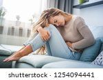 Young woman suffering from...