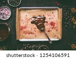 spoon with melted chocolate on... | Shutterstock . vector #1254106591