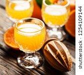 homemade mandarin juice on the... | Shutterstock . vector #1254109144