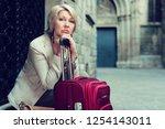 elegant mature tourist woman is ... | Shutterstock . vector #1254143011