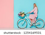 smiling woman in pink clothing...   Shutterstock . vector #1254169531