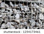photograph of gabion baskets... | Shutterstock . vector #1254173461