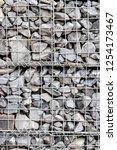 photograph of gabion baskets... | Shutterstock . vector #1254173467