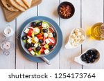 traditional greek salad with... | Shutterstock . vector #1254173764