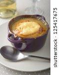 onion soup in a purple bowl