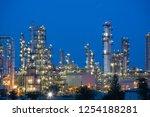 twilight scene of oil refinery... | Shutterstock . vector #1254188281
