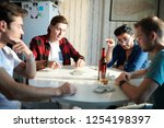 group of young men sitting at... | Shutterstock . vector #1254198397