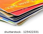 stack of credit cards on white...   Shutterstock . vector #125422331