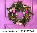 christmas wreath on the doors.... | Shutterstock . vector #1254377041