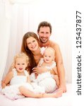 happy young family. indoors. | Shutterstock . vector #125437877