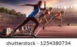 female athletes sprinting.... | Shutterstock . vector #1254380734